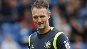 clint hill: carlisle's former crystal palace and qpr defender retires aged 39