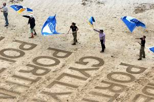 Cornwall's cleanest beaches have been revealed in stunning fashion with sand art and flag waving