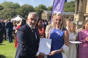 Great British Bake Off judge Paul Hollywood hands Millfield student a gold Duke of Edinburgh award at Buckingham Palace