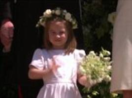 Princess Charlotte waves at crowds as Prince George cowers behind at Royal wedding in Windsor