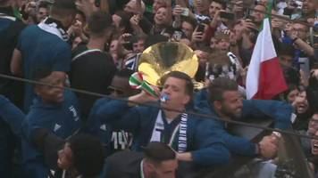 Wojciech Szczesny: Juventus keeper catches horn thrown by fan at victory parade