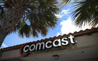 """government """"not minded"""" to refer comcast-sky takeover"""