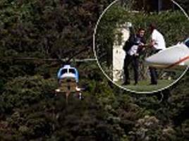 philippe coutinho arrives for brazil training in rio by helicopter