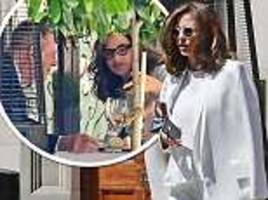 trinny woodall dons all white ensemble for date with charles saatchi