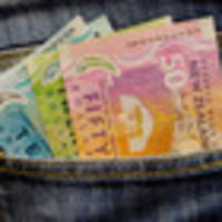 New Zealand dollar holds gains against US