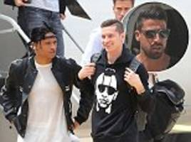 mesut ozil, leroy sane and germany team-mates arrive in italy for training camp ahead of world cup