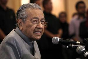 Malaysia PM Mahathir says will review MH370 search contract