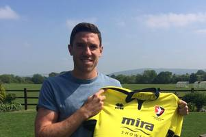 former newcastle united midfielder is cheltenham town's fourth new signing