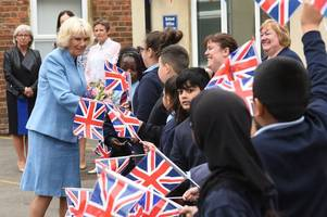 duchess of cornwall sweeps into gloucester to be inspired and delighted at moving stories