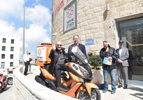 alan dershowitz first ride on a united hatzalah ambucycle