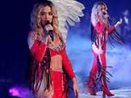 Rita Ora flashes abs in fringed red co-ords to perform in GNTM finale