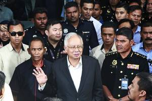 police find $28 million in cash in raids linked to former malaysian prime minister