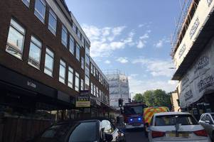 Emergency services rush to flats near Brentwood train station