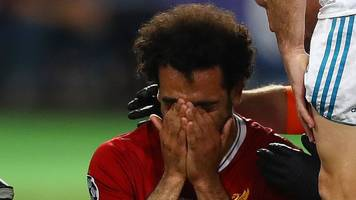 Champions League final: Liverpool striker Mohamed Salah forced off with shoulder injury