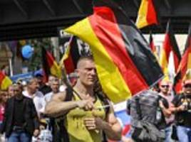 far-right demonstrators chanting 'we are the people' march through the streets of berlin