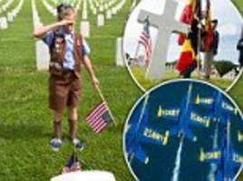 scouts place flags at the graves of veterans across the country in preparation for memorial day