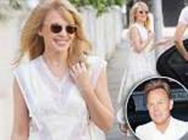 Kylie Minogue shows off her age-defying looks as she celebrates her 50th birthday