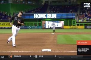 watch: justin bour smacks home run 422 ft.