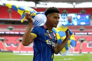 bristol rovers join sunderland, wigan athletic and burton albion in interest in signing wimbledon striker