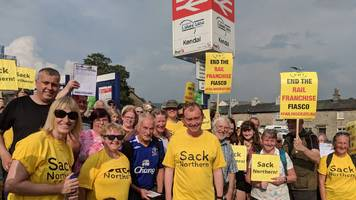 tim farron leads lakes line protest march