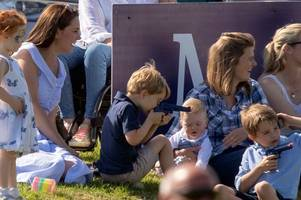 opinion split as prince george seen playing with toy gun at gloucestershire polo club