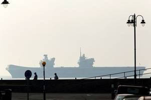 the royal navy's largest ever ship spotted off the coast of cornwall
