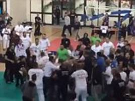 Clip shows 50-man brawl break out after British fighter won martial arts contest in Sicily
