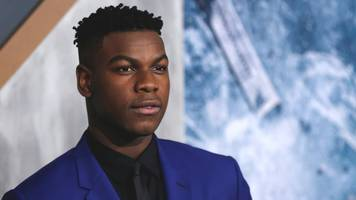 John Boyega tells Star Wars fans to stop harassing cast