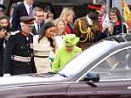 Awkward moment the Queen lets Meghan Markle get into the car first
