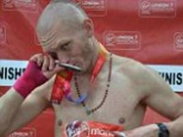 homeless man who picked up marathon runner's lost number admits fraud