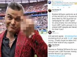 was robbie williams responding to lgbt critics during his world cup performance middle finger?