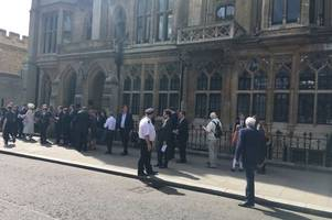 photos show guests gathering at stephen hawking memorial