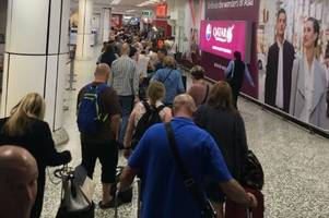 birmingham airport chaos as hundreds of furious passengers stranded overnight after runway shut down