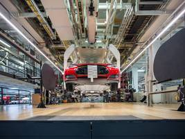 Tesla's new Model 3 assembly line is in a giant tent outside its Fremont factory (TSLA)