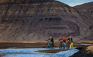 mountain bikers navigate their way through uninhabited island near the north pole - located 750 miles from the north pole, averaging 0 degrees, and no nightfall ... this crew got the experience they were looking for.