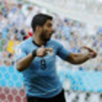 Fifa World Cup: Suarez scores as Uruguay and Russia advance at World Cup