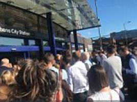 angry commuters kick down gates in at st albans railway station because of thameslink delays