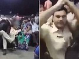 police officer 'gropes woman at train station in india while he pretended to be asleep'