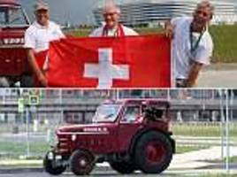 switzerland fans travel 1,240 miles to the world cup in a tractor