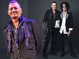 johnny depp presents kerrang! award to aerosmith's joe perry