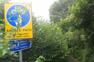 volunteers are clearing an overgrown path a year after £35k improvements