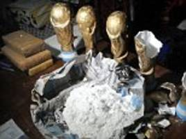 Argentine police find fake gold World Cup trophies packed with COCAINE in Buenos Aires