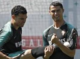 cristiano ronaldo gives pepe a helping hand during portugal training