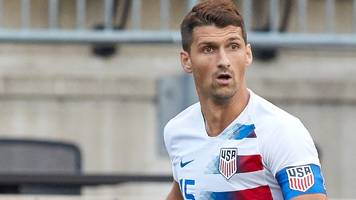 eric lichaj: hull city sign usa defender from nottingham forest