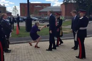 Theresa May sends internet into meltdown with bizarre Prince William curtsy