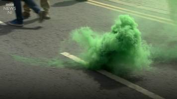 smoke bombs thrown at belfast protests