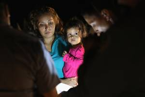 crying migrant girl on time cover wasn't separated from her mother