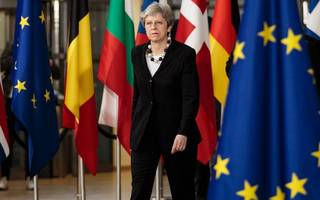 May caught in Brexit crossfire over lack of progress in negotiations