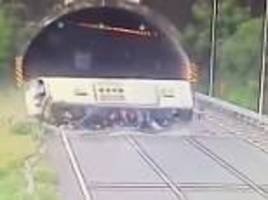 passengers are thrown out of windows after out-of-control coach overturns on a chinese motorway