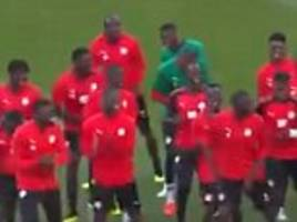 senegal show off cheerful warm-up routine as they enjoy synchronised group dance ahead of japan draw